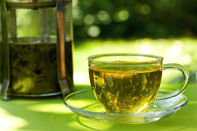 Xícara com chá verde