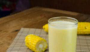 fresh sweet corn juice and smoothie on wooden background