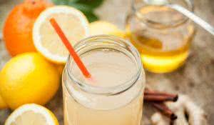 Healthy drink with lemon, cinammon, ginger and honey to prevent cold