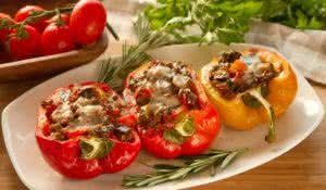 Baked stuffed red bell pepper filled with minced meat, onion, rice, tomato and green onion