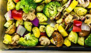 Preparing fresh roasted mixed vegetables for dinner.