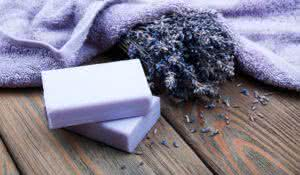 Handmade lavender soap with dry lavender flowers and towel