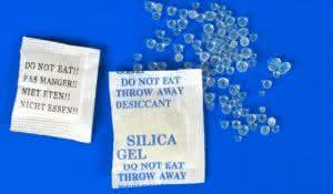 Macro of silica gel bags on blue background