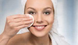 Body care, happy attractive women removing makeup in the bathroom