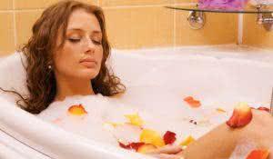 Young beautiful woman relaxing in a bath