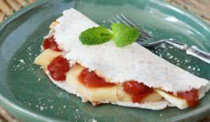 Casabe (bammy, beiju, bob, biju) - flatbread made from cassava (tapioca) with cheese and goiabada jam (Romeo and Juliet dessert). Selective focus