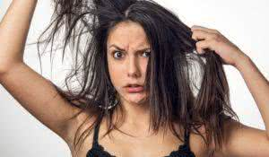 Brunette teenager girl with anger expression pulling her messy hair