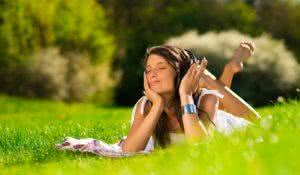 Beautiful Young Woman with Headphones Outdoors. Enjoy Music