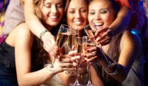 Cheerful girls clinking glasses of champagne at the party