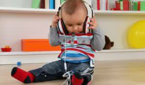 Portrait of a baby listening to music with headphones